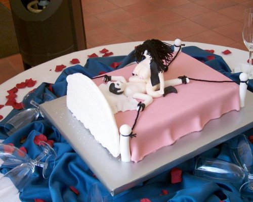 cake decorated with a bondage theme