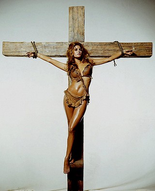 Raquel Welch bound to a crucifix to publcize movie One Million Years B.C.