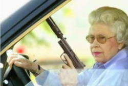 The Queen driving and holding an automatic pistol with a silencer