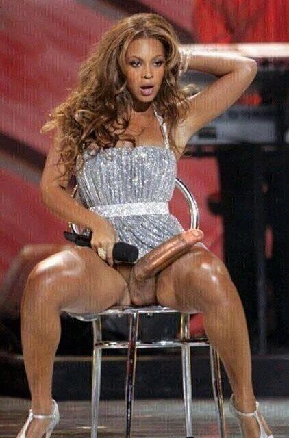 satire image of Beyonce with a big cock holding a microphone
