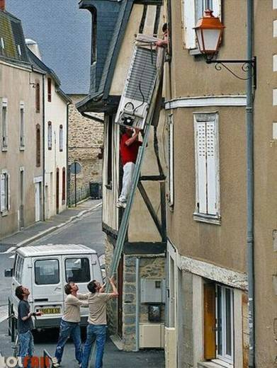 man with helpers about to have a major ladder fail