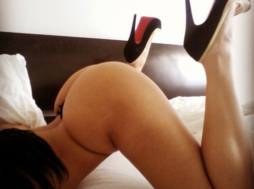 woman in the ass up face down position wearing black Laboutin high heels