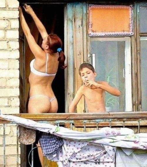 humorous image of kid smoking something with a woman in bra and thong in the background