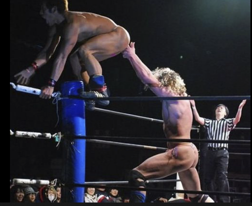 humorous image of pro wrestlers in a compromising position